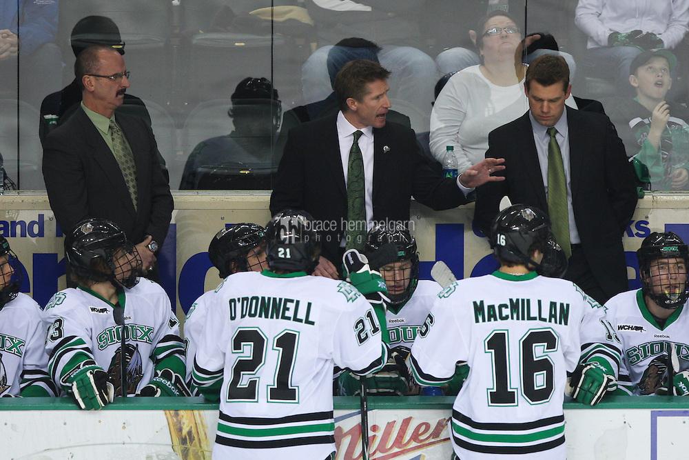 13 January 2012: North Dakota head coach Dave Hakstol against the Minnesota Golden Gophers at Ralph Engelstad Arena in Grand Forks, ND. North Dakota defeated Minnesota 2-1.