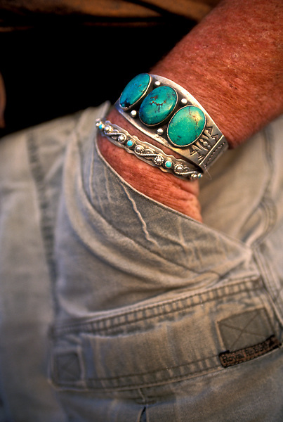 Man's Wrist with Torquoise and Silver Bracelets