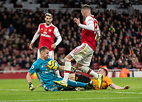 Football - 2019 / 2020 Premier League - Arsenal vs. Wolverhampton Wanderers<br /> <br /> Bernd Leno (Arsenal FC) stops the ball with his chest to stop Diogo Jota (Wolverhampton Wanderers) from scoring at The Emirates Stadium.<br /> <br /> COLORSPORT/DANIEL BEARHAM