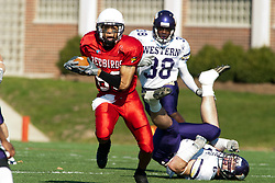 29 October 2005: Redbird Jason Horton heads upfield leaving Leathernecks scattered behind him. With a final score of 31 - 17, Western Illinois University Leathernecks collared the Illinois State University Redbirds knocking them from their 18th ranked perch at Hancock Field on Illinois State's campus in Normal IL
