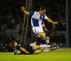 Southend United's Kevan Hurst tackles Bristol Rovers' Andy Bond - Photo mandatory by-line: Seb Daly/JMP - Tel: Mobile: 07966 386802 27/09/2013 - SPORT - FOOTBALL - Roots Hall - Southend - Southend United V Bristol Rovers - Sky Bet League Two