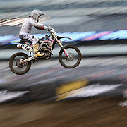 A blur of motion as Jake Oswald, Honda, flies through the air during the Monster Energy AMA Supercross series held at MetLife Stadium. 62,217 fans attended the event held for the first time at MetLife Stadium, New Jersey, USA. 26th April 2014. Photo Tim Clayton