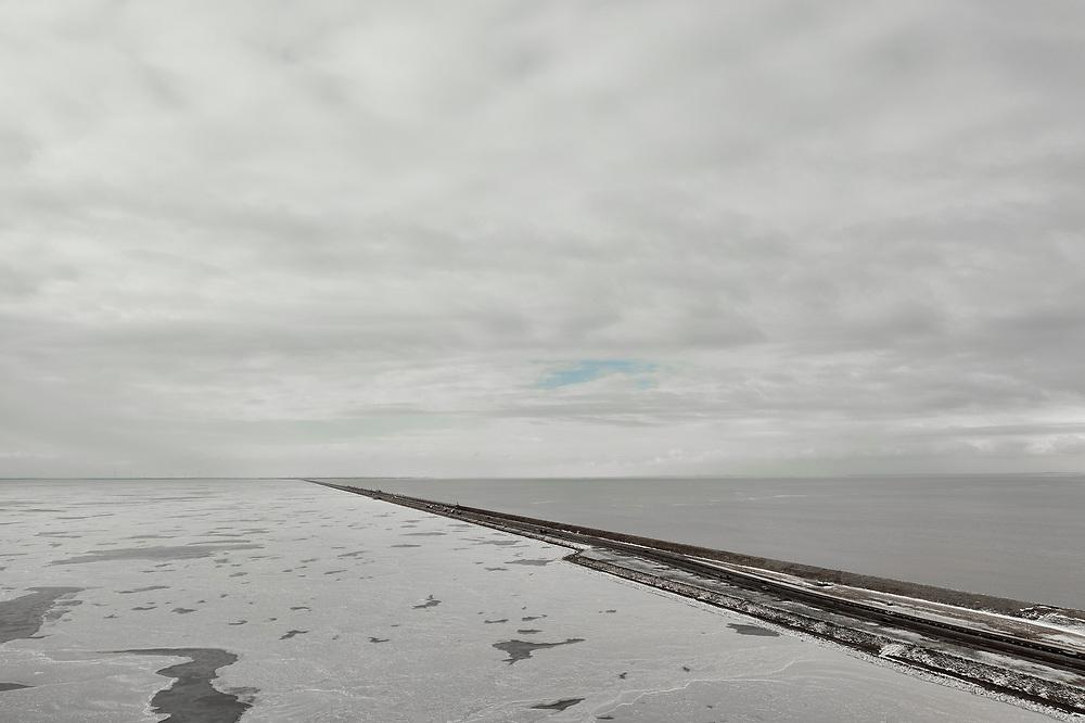 Nederland, Friesland, Breezanddijk, 10-02-2021; IJsselmeer met ijs, zicht op de Waddenzee. <br /> Winterlandschap. IJsselmeer with ice, a view of the Wadden Sea. Winter landscape.<br /> drone-opname (luchtopname, toeslag op standaard tarieven);<br /> drone recording (aerial, additional fee required);<br /> copyright foto/photo Siebe Swart