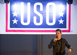 December 21, 2017 - Sevilla, Spain - Comedian and actor Adam Devine performs during Chairman?'s USO Holiday Tour at Moon Air Base Dec. 21, 2017. Marine Corps Gen. Joe Dunford, chairman of the Joint Chiefs of Staff, and Command Sgt. Maj. John W. Troxell, senior enlisted advisor to the chairman of the Joint Chiefs of Staff, along with USO entertainers, visited service members who are deployed from home during the holidays at various locations across Europe and the Middle East. .(Credit Image: ? US Navy/ZUMA Wire/ZUMAPRESS.com)