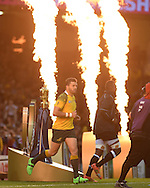 Adam Ashley-Cooper of Australia runs past the Webb Ellis trophy onto the pitch at the start of the game. Rugby World Cup 2015 pool A match, Australia v Fiji at the Millennium Stadium in Cardiff, South Wales  on Wednesday 23rd September 2015.<br /> pic by  Andrew Orchard, Andrew Orchard sports photography.