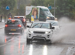 © Licensed to London News Pictures. 27/08/2020. London, UK. Cars and buses get caught in torrential rain and flash flooding in Putney in South West London as thunderstorms hit London and the South East. The Met Office have issued yet another yellow weather warning for thunderstorms with heavy rain and potential disruption to transport over the next 24 hours. Photo credit: Alex Lentati/LNP