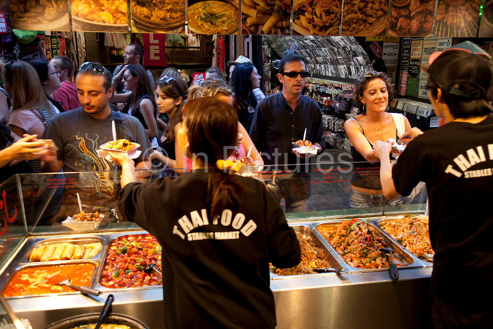 Indoor foods stalls on a busy day at Camden Market, North London. Camden Lock is a crowded hang out for young Londoners.