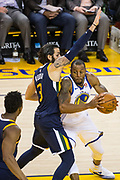 Golden State Warriors forward Andre Iguodala (9) takes the ball to the basket against the Utah Jazz at Oracle Arena in Oakland, Calif., on December 27, 2017. (Stan Olszewski/Special to S.F. Examiner)