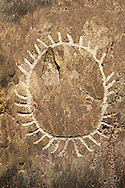 """Prehistoric  petroglyphs, rock carvings, of a sun design carved by the the prehistoric Camuni people in the Copper Age around the 3rd milleneum BC, Stele """"Bagnolo 1"""" found in 1963 from Malegno near Bangnolo Ceresolo. Museo Nazionale della Preistoria della Valle Camonica ( National Museum of Prehistory in Valle Cominca ), Lombardy, Italy. Grey Art Background .<br /> <br /> If you prefer you can also buy from our ALAMY PHOTO LIBRARY  Collection visit : https://www.alamy.com/portfolio/paul-williams-funkystock/valcamonica-menhir-museum.html<br /> Visit our PREHISTORIC PLACES PHOTO COLLECTIONS for more  photos to download or buy as prints https://funkystock.photoshelter.com/gallery-collection/Prehistoric-Neolithic-Sites-Art-Artefacts-Pictures-Photos/C0000tfxw63zrUT4"""
