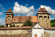 The Fortified Saxon Evangelical church of Valea Viilor. A Gothic church built in 1414 with a three layered defensive tower. Sibiu, Transylvania. A World Heritage Site .<br /> <br /> Visit our ROMANIA HISTORIC PLACXES PHOTO COLLECTIONS for more photos to download or buy as wall art prints https://funkystock.photoshelter.com/gallery-collection/Pictures-Images-of-Romania-Photos-of-Romanian-Historic-Landmark-Sites/C00001TITiQwAdS8<br /> .<br /> Visit our MEDIEVAL PHOTO COLLECTIONS for more   photos  to download or buy as prints https://funkystock.photoshelter.com/gallery-collection/Medieval-Middle-Ages-Historic-Places-Arcaeological-Sites-Pictures-Images-of/C0000B5ZA54_WD0s