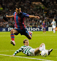 Photo. Jed Wee.Digitalsport<br /> Glasgow Celtic v FC Barcelona, UEFA Champions League, 14/09/2004.<br /> Barcelona's Giovanni van Bronkhorst hurdles over a challenge from Celtic's Juninho, in a tackle that earns the Celtic man a yellow card.