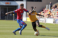 Dagenham's Matt Partridge (l) challenges for the ball with Newport's David Tutonda. Skybet football league two match , Newport county v Dagenham & Redbridge at Rodney Parade in Newport, South Wales on Saturday 18th April 2015.<br /> pic by David Richards, Andrew Orchard sports photography.
