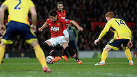 Manchester United's Shinji Kagawa runs with the ball amongst Sunderland players