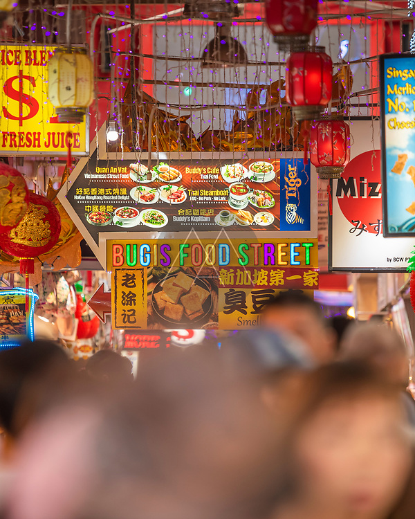 Singapore - 26 March 2019: View of people eating street food in a local market in Singapore downtown.