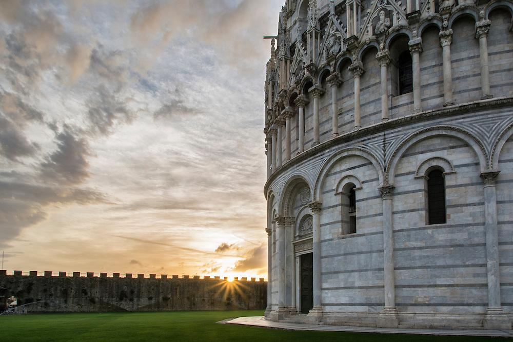 Sun almost vanishing behind the Duomo in Pisa.