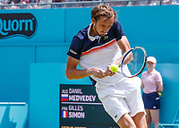 Tennis - 2019 Queen's Club Fever-Tree Championships - Day Six, Saturday<br /> <br /> Men's Singles, Semi Final: Daniil Medvedev (RUS) Vs. Gilles Simon (FRA) <br /> <br /> Daniil Medvedev (RUS) with his eyes focused on the ball prepares to strike the backhand on Centre Court.<br />  <br /> COLORSPORT/DANIEL BEARHAM