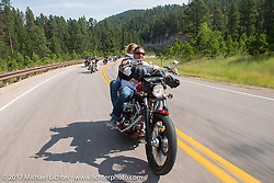 Aaron Green and Melody Seaton on the Aidan's Ride to raise money for the Aiden Jack Seeger nonprofit foundation to help raise awareness and find a cure for ALD (Adrenoleukodystrophy) during the annual Sturgis Black Hills Motorcycle Rally. Vanocker Canyon between Sturgis and Nemo, SD, USA. Tuesday August 8, 2017. Photography ©2017 Michael Lichter.