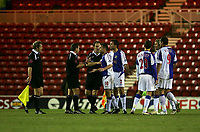 Photo: Andrew Unwin.<br /> Middlesbrough v Blackburn Rovers. Carling Cup. 21/12/2005.<br /> Blackburn's Paul Dickov (#10) continues to argue with the referee, Alan Wiley, after the half-time whistle has blown.
