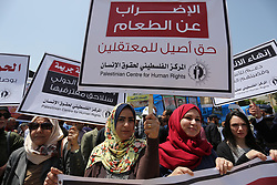 April 27, 2017 - Gaza City, Gaza Strip, Palestinian Territory - Palestinians take part in a protest to show solidarity with Palestinian prisoners on hunger strike in Israeli jails, in Gaza city on April 27, 2017  (Credit Image: © Ashraf Amra/APA Images via ZUMA Wire)