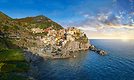 fishing village and harbour of Manarola at sunset , Cinque Terre National Park, Liguria, Italy .<br /> <br /> Visit our CINQUE TERRE PHOTO COLLECTIONS for more  photos  to download or buy as prints https://funkystock.photoshelter.com/gallery/Cinque-Terre-Pictures-Photos-of-Cinque-Terre-Italy/G0000gYEYY_aCqgI/C0000qxA2zGFjd_k<br /> If you prefer to buy from our ALAMY PHOTO LIBRARY  Collection visit : https://www.alamy.com/portfolio/paul-williams-funkystock/vernazza-cinque-terre.html