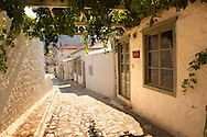 Narrow streets & houses of Hydra,  Greek Saronic Islands. .<br /> <br /> Visit our GREEK HISTORIC PLACES PHOTO COLLECTIONS for more photos to download or buy as wall art prints https://funkystock.photoshelter.com/gallery-collection/Pictures-Images-of-Greece-Photos-of-Greek-Historic-Landmark-Sites/C0000w6e8OkknEb8