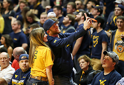 Feb 10, 2018; Morgantown, WV, USA; Country artist Cole Swindell takes a selfie with a fan during the second half at WVU Coliseum. Mandatory Credit: Ben Queen-USA TODAY Sports
