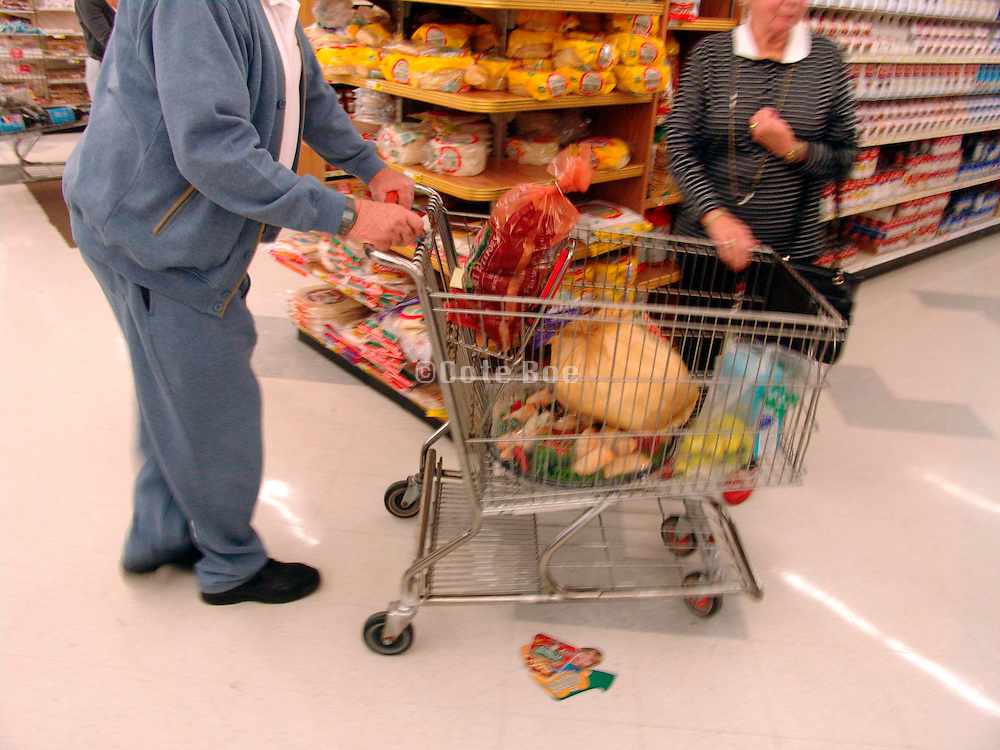 Elderly couple buying groceries.
