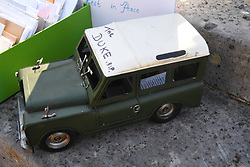 A model Land Rover left by a member of the public outside Buckingham Palace following the death of the Duke of Edinburgh on display in the gardens of Marlborough House, London, during a visit by the Prince of Wales and the Duchess of Cornwall. Picture date: Thursday April 15, 2021.