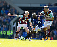 Everton's Arouna Kone battles with Burnley's Scott Arfield (right) and Ben Mee (left)<br /> <br /> Photographer Stephen White/CameraSport<br /> <br /> Football - Barclays Premiership - Everton v Burnley - Saturday 18th April 2015 - Goodison Park - Everton<br /> <br /> © CameraSport - 43 Linden Ave. Countesthorpe. Leicester. England. LE8 5PG - Tel: +44 (0) 116 277 4147 - admin@camerasport.com - www.camerasport.com
