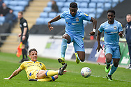 Coventry City forward (on loan from Wolverhampton Wanderers)Bright Enobakhare (24) leaps to avoid a tackle during the EFL Sky Bet League 1 match between Coventry City and Bristol Rovers at the Ricoh Arena, Coventry, England on 7 April 2019.