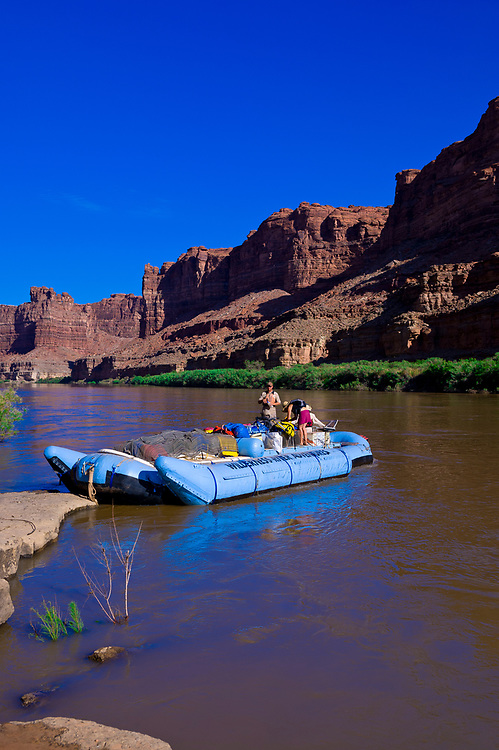 A Wilderness River Adventures motorized pontoon rafting down the Meander Canyon section of the Colorado River, making camp near Monument Creek, in Canyonlands National Park, Utah, USA.