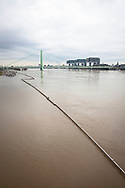 flood of the river Rhine on February 5th. 2021, view over the flooded bank in the district Deutz to the Severins bridge and the Rheinau harbour with the Crane Houses, Cologne, Germany.<br /> <br /> Hochwasser des Rheins am 5. Februar 2021, Blick ueber das ueberflutete Ufer im Stadtteil Deutz zur Severinsbruecke und zum Rheinauhafen mit den Kranhaeusern, Koeln, Deutschland.