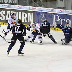 Torversuch EHC Red Bull Muenchen durch 13 Michael Wolf (Spieler EHC Reb Bull Muenchen), <br /> mit auf dem Bild 51 Timo Pielmeier (Torwart ERC Ingolstadt), 17 Petr Taticek (Spieler ERC Ingolstadt), 14 Dustin Friesen (Spieler ERC Ingolstadt), 22 Brain Salcido (Spieler ERC Ingolstadt) und 15 Jason Jaffray (Spieler EHC Reb Bull Muenchen) beim Spiel in der DEL, ERC Ingolstadt (blau) - EHC Red Bull Muenchen (weiss).<br /> <br /> Foto © PIX-Sportfotos *** Foto ist honorarpflichtig! *** Auf Anfrage in hoeherer Qualitaet/Aufloesung. Belegexemplar erbeten. Veroeffentlichung ausschliesslich fuer journalistisch-publizistische Zwecke. For editorial use only.