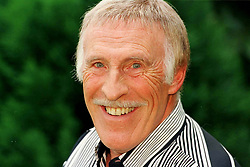 File photo dated 12/06/98 of Sir Bruce Forsyth in the garden of his Surrey home celebrating being awarded an OBE in the Queen's birthday honours list, as the veteran entertainer has died aged 89.
