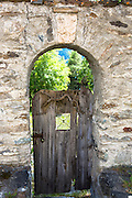 Garden gate in the Engadine Valley in the historic village of Guarda, Switzerland