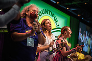 Rebecca Futty (center) sings and dances at the 36th Biennial Convention of the Lutheran Women's Missionary League on Friday, June 26, 2015, at the Iowa Events Center in Des Moines, Iowa. LCMS Communications/Erik M. Lunsford