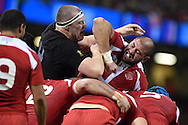 Giorgi Chkhaidze of Georgia ® battles  with Brodie Retallick of New Zealand in a ruck.. Rugby World Cup 2015 pool c match, New Zealand v Georgia at the Millennium Stadium in Cardiff, South Wales  on Friday 2nd October 2015.<br /> pic by  Andrew Orchard, Andrew Orchard sports photography.