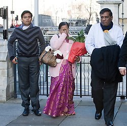 © Licensed to London News Pictures. 04/01/2012. London, UK.  L to R RAKESH SONAWANE (Brother-in-law) YOGINI BIDVE (mother), SUBHASH BIDVE (Father), family of  murdered student ANUJ BIDVE arriving at the Houses of Parliament London on January 4th, 2012 after arriving in the UK from Mumbai. The Family of 20 year-old ANUJ BIDVE, are expected to travel to Manchester to visit the scene where ANUJ was shot dead.  Photo credit: Ben Cawthra/LNP