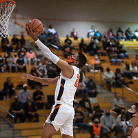 Gallup's Jeffery Yazzie (21) drives to the basket for a layup against Grants Tuesday night at Gallup High School in Gallup.