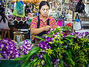 21 OCTOBER 2014 - BANGKOK, THAILAND:  Vendors create floral arrangements in the Pak Khlong Talat market on the Chao Phraya River in Bangkok. Most of these floral arrangements will be used in religious ceremonies and for merit making in temples.    PHOTO BY JACK KURTZ