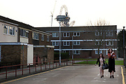 Scene around Carpenters Estate near to the 2012 London Olympic Park in East London. Residents in this area are concerned for many reasons including living in the shadow of the mostly disliked steel tower and the possible threat that the entire estate site may be sold off to UCL (University College London). People in this area generally feel very negative towards the Olympics, which they feel is not going to benefit them at all. Meanwhile the new shopping complex which is next to their estate, there are high end shops selling goods they simply cannot afford.