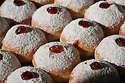 Sufganiyah a traditional Jewish Doughnut eaten during Hannukah with red jam and sugar powder