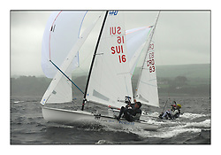 470 Class European Championships Largs - Day 2.Wet and Windy Racing in grey conditions on the Clyde...SUI16, Yannick BRAUCHLI, Romuald HAUSSER, Segel Club Enge, CRO83, Sime FANTELA, Igor MARENIC,