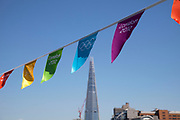 London 2012 Olympic Games bunting adds a touch of colour along the River Thames in central London, UK. With The Shard skyscraper looming in the background.