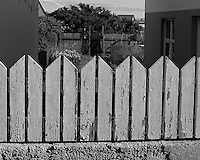 Fence Behind a Fence. Vestmannaeyjar (Westman), on Heimaey Island Iceland. Image taken with a Leica X2 camera (ISO 100, 24 mm, f/5.6, 1/640 sec). In camera B&W conversion. Nikonians Iceland Photo Adventure.