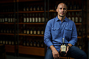 Amir Peay, owner of the James E Pepper Distillery, poses for a portrait inside the Lexington, Ky distillery. Peay lost about half of its European business after then President Donald Trump's tariffs on steel prompted the European Union to retaliate and make US bourbon more expensive in 2018. Despite a new administration, the tariffs are still in place.