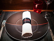 29 JANUARY 2016 - BANGKOK, THAILAND: A place setting at L'atelier de Joel Robuchon, an exclusive French restaurant owned by French chef Joel Robuchon. The restaurant features counter style seating which looks into the kitchen so diners can watch the chefs work.          PHOTO BY JACK KURTZ