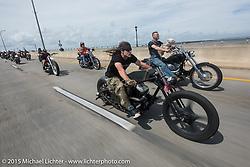 "Brad Gregory (L) on his custom 2012 Harley-Davidson Sportster next to ""Moonshiner Josh"" Owens with his dog ""Cutie Pie"" as they ride their 2005 Harley-Davidson Softail over the Granada Bridge back into Daytona Beach during Daytona Beach Bike Week 2015. FL, USA. March 13, 2015.  Photography ©2015 Michael Lichter."