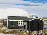 """In the Argentine Islands, Antarctica, Wordie House (1947-1954) has been restored and is designated under the Antarctic Treaty System as Historic Site and Monument No. 62. The United Kingdom first established meteorological research here as Base F or """"Argentine Islands"""" on Winter Island in 1947. The main hut, built on the site of an earlier British Graham Land Expedition hut, was named after Sir James Wordie, a member of Shackleton's Imperial Trans-Antarctic Expedition who visited during its construction. The original main hut, """"Wordie House,"""" now comprises the kitchen and bunk room. The base was extended in 1951 to include a generator shed, office, store, and toilet. A larger hut was built on nearby Galindez Island in 1954 and renamed Faraday Station in 1977. Researchers at Faraday Station shocked the scientific community by discovering the Antarctic """"ozone hole"""" in 1985. Operational transfer to Ukraine in 1996 renamed Faraday Station to Vernadsky Research Base (Akademik Vernadsky)."""