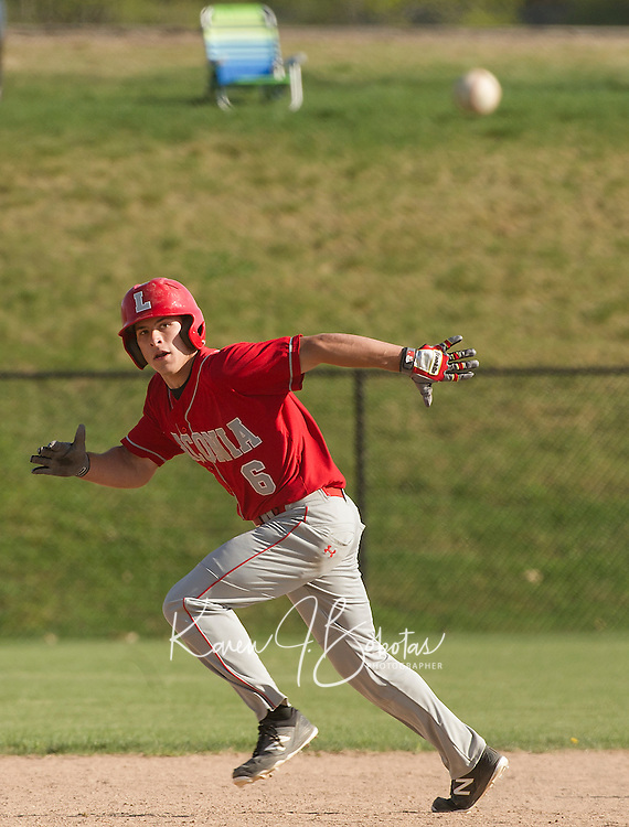 Laconia's Andrew Salta watches a line drive as he heads towards third base during Friday afternoon varsity baselball with White Mountain.  (Karen Bobotas/for the Laconia Daily Sun)
